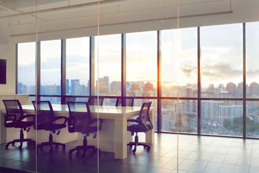 View of office conference room with sunset light in windows