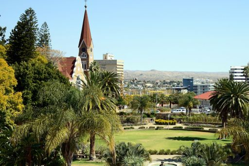 View of park with trees mountains and buildings, Namibia