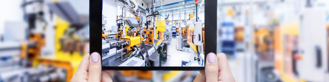View of robotic factory through tablet
