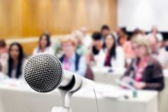 KPMG IFRS breaking news image: microphone in front of audience