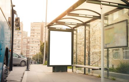 White bill board at empty bus stop