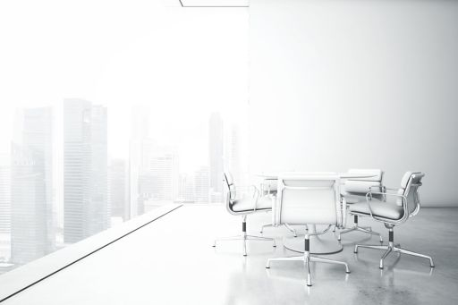 white meeting chairs around table as a symbol for KPMGs HAM2 services