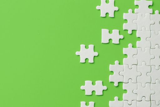 white puzzle on green background