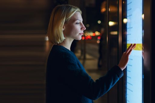 Woman at touchscreen