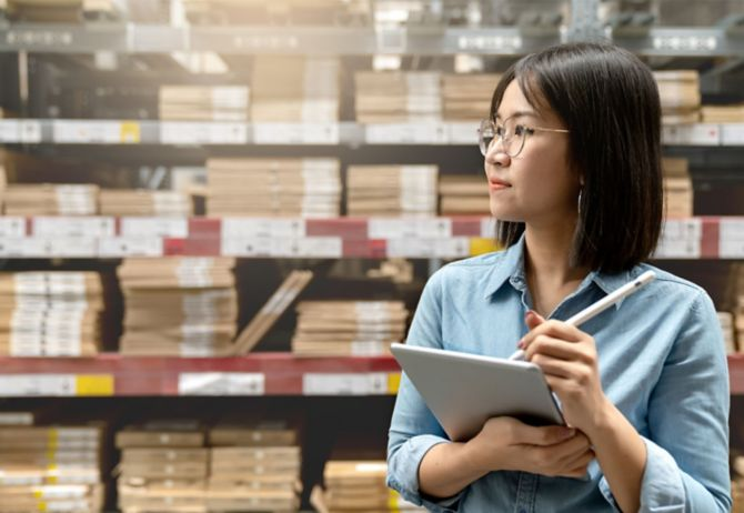 Entrepreneur woman holding smart tablet computer with fulfillment service business warehouse management