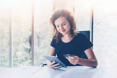 Woman holding tablet and credit card