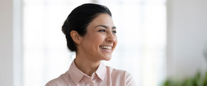 Woman in a pink shirt smiling