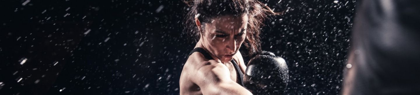 Woman in black playing boxing