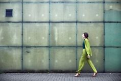 Woman in green formal dress walking