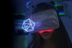 Woman in VR headset looking at holographic shape