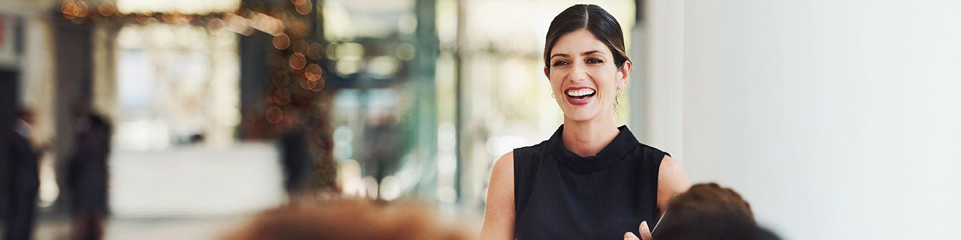 Woman laughing with blur lights in background