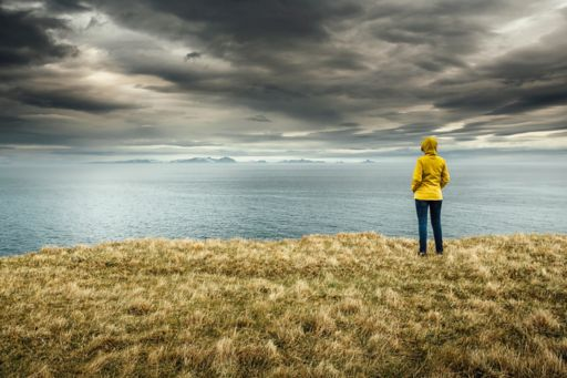 Woman looking over storm clouds