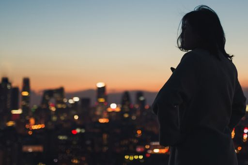 Woman looking at city lights