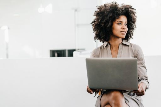 woman on laptop looking to her left