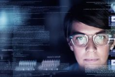 Women reading digital screen with coding