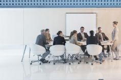 Woman speaking to business people