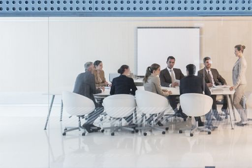 Woman speaking in a business meeting