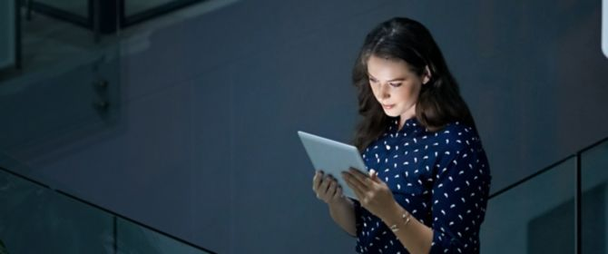 Woman using tablet in office