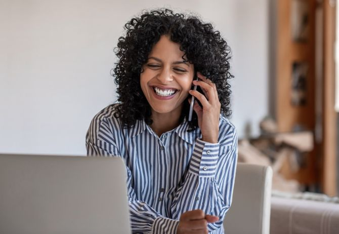Woman talking on the phone and laughing