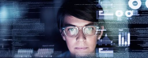 Woman with glasses looking at a digital screen