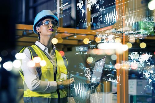 Woman with helmet operating virtual computer graphs