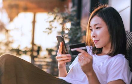 Woman with phone and credit card