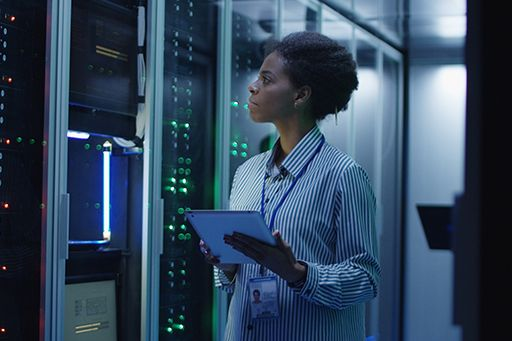 Woman working on a tablet at the data center