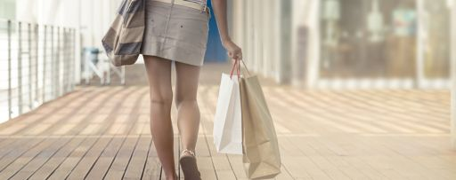 Women walking away with shopping bags