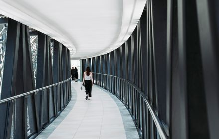 Women walking in corridor with black bars