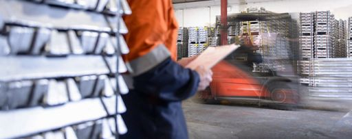 Worker in warehouse holding a notepad