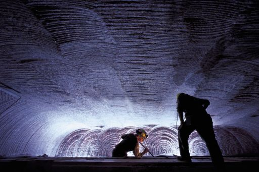 Men working in an underground potash mine