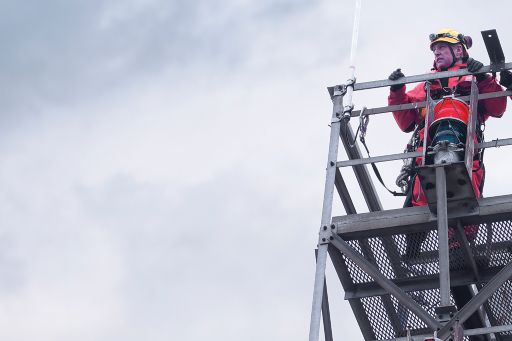 Workers on radio tower