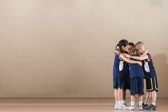Young basketball players in group huddle