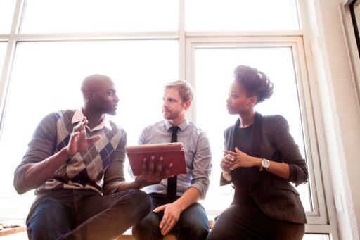 Young business people talking at casual meeting