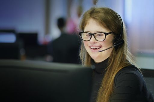 Young school leaver working in an office