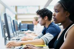 Young students using computer in class