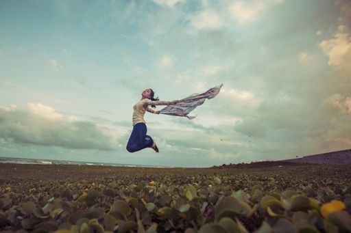Young woman jumping in celebration